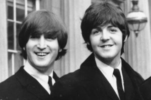 **FILE**   This Oct. 26, 1965 file photo shows John Lennon, left, and Paul McCartney as they smile during a ceremony at Buckingham Palace in London. The British Broadcasting Corp. will air a long lost Beatles interview featuring John Lennon and Paul McCartney talking about the day they met and their songwriting partnership. The precious film sat forgotten for 44 years in a garage in south London until film fan Richard Jeffs realized a piece of pop history was contained inside.    (AP Photo, FILE)